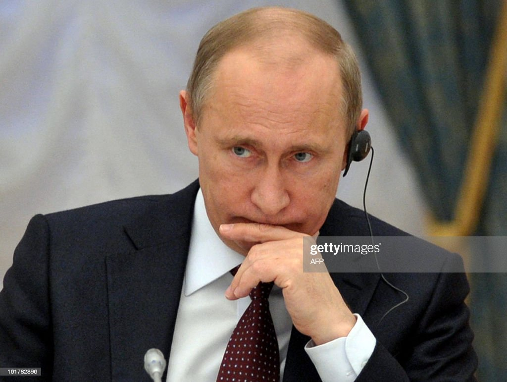 Russia's President <a gi-track='captionPersonalityLinkClicked' href=/galleries/search?phrase=Vladimir+Putin&family=editorial&specificpeople=154896 ng-click='$event.stopPropagation()'>Vladimir Putin</a> attends a meeting with G20 states finance ministers in the Kremlin in Moscow on February 15, 2013. The unpredicted meteor strike in the Urals city of Chelyabinsk that left yesterday hundreds of people injured, left some Russian officials calling for the creation of a global system of space object defence. AFP PHOTO/ RIA-NOVOSTI POOL / ALEXEI NIKOLSKY