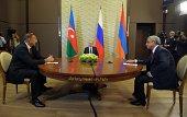 Russia's President Vladimir Putin Azerbaijan President Ilham Aliyev and Armenia President Serzh Sergsyan speak during their meeting in Sochi on...