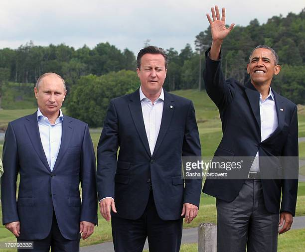 Russia's President Vladimir Putin Britain's Prime Minister David Cameron and US President Barack Obama arrive for the 'family' group photograph at...