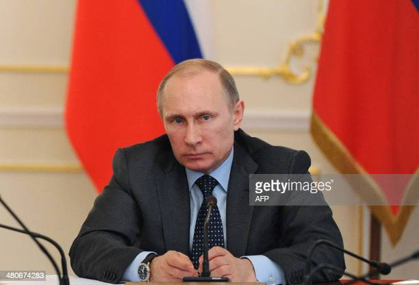 Russia's President Vladimir Putin chairs a government meeting in the NovoOgaryovo residence outside Moscow on March 26 2014Both the United States and...