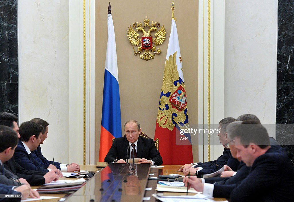 Russia's President Vladimir Putin (C) chairs a meeting of his envoys in Federal Districts in the Kremlin in Moscow, on January 30, 2013. Russia said today it was pulling out of a decade-old drug control agreement with the United States in the latest sign of a deterioration in ties since Putin's return to the Kremlin last year. AFP PHOTO/ RIA-NOVOSTI/ POOL / ALEXEI NIKOLSKY