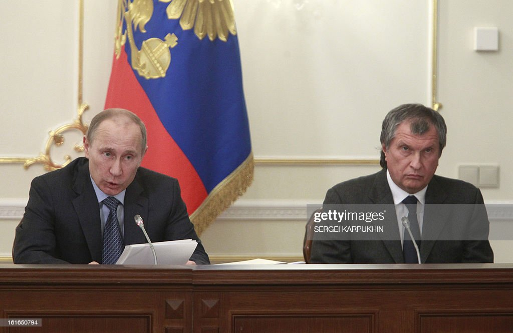 Russia's President Vladimir Putin (L) chairs a meeting on issues of fuel and energy complex at the Novo-Ogaryovo state residence outside Moscow, on February 13, 2013, with the state-controlled Russian oil giant Rosneft CEO, Igor Sechin (R) attending. A Kremlin energy commission considering yesterday a request a Gazprom rival for rights to export liquefied natural gas, chipping away at the state's gas export monopoly which could lead to broader reform.