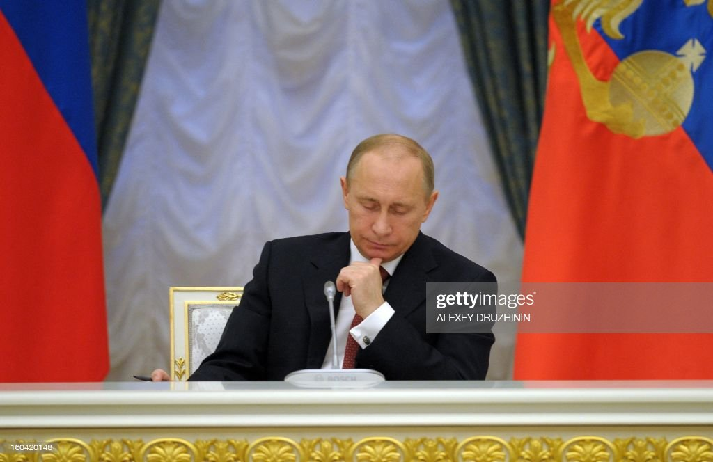 Russia's President Vladimir Putin chairs the Expanded Cabinet Meeting in the Kremlin in Moscow, on January 31, 2013. Human Rights Watch condemned today the Russian authorities under President Vladimir Putin for unleashing the toughest crackdown against civil society since the fall of the Soviet Union in 1991.