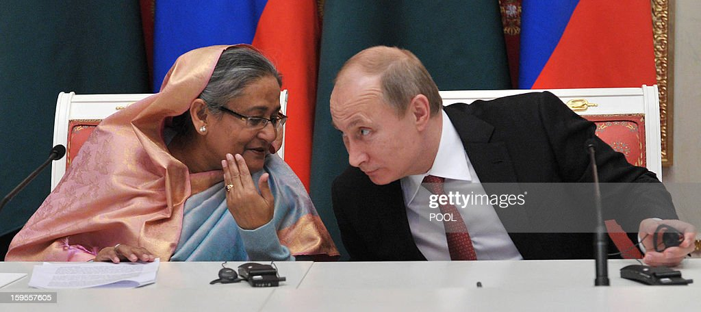 Russia's President Vladimir Putin (R) confers with Bangladesh's Prime Minister Sheikh Hasina as they take part a signing ceremony between Russia and Bangladesh in Moscow, on January 15, 2013. Putin met yesterday Bangladesh's Prime Minister for talks and for the signature of the impoverished Asian nation's largest defence contract since its independence in 1971.