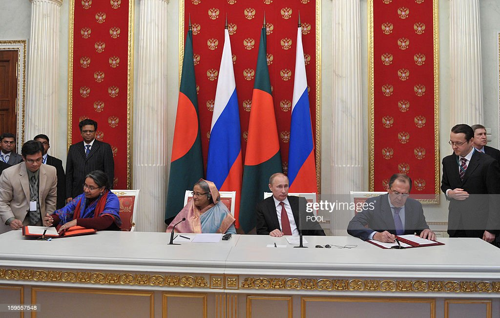 Russia's President Vladimir Putin (3rd R), Foreign Minister Sergei Lavrov (2nd R) and Bangladesh's Prime Minister Sheikh Hasina (4th R) take part a signing ceremony between Russia and Bangladesh in Moscow, on January 15, 2013. Putin met yesterday Bangladesh's Prime Minister for talks and for the signature of the impoverished Asian nation's largest defence contract since its independence in 1971.