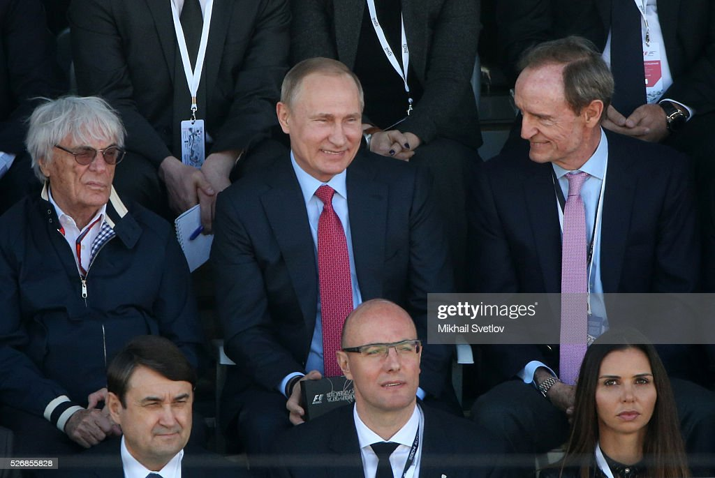 Russia's President Vladimir Putin (C), Formula 1 Executive Bernie Ecclestone (L) and former IOC member Jean-Claud Killiy (R) are seen during the Formula One Russian Grand Prix at the Sochi Autodrom racetrack on May 1, 2016 in Sochi, Russia.
