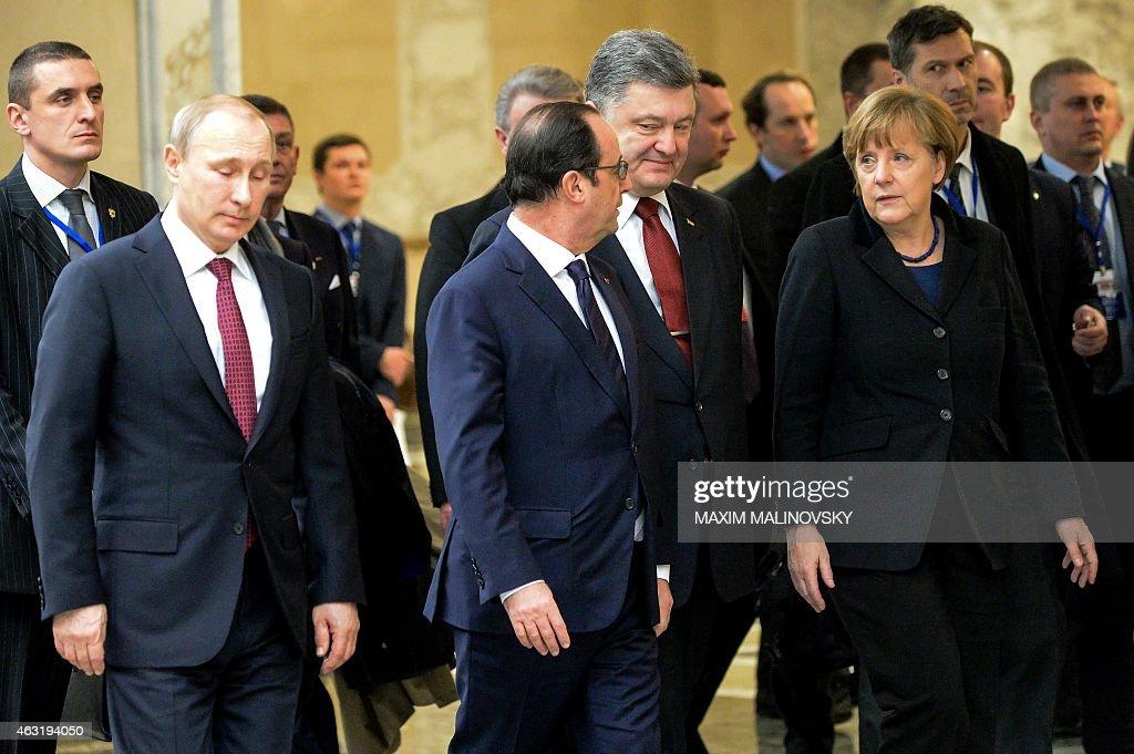 Russia's President Vladimir Putin France's President Francois Hollande Ukrainian President Petro Poroshenko and German Chancellor Angela Merkel walk...