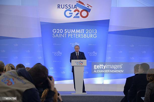 Russias President Vladimir Putin gives a press conference at the end of the G20 summit on September 6 2013 in Saint Petersburg World leaders at the...