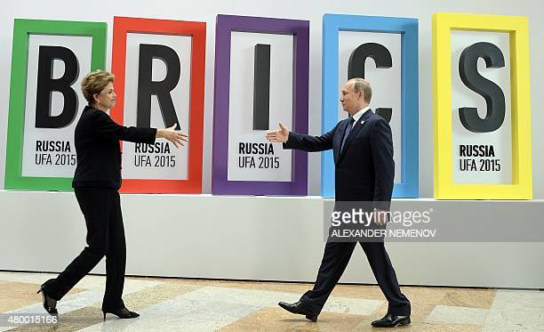 Russia's President Vladimir Putin greets Brazil's President Dilma Rousseff during a welcome ceremony in Ufa on July 9 2015 at the start of the 7th...
