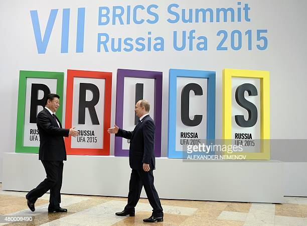 Russia's President Vladimir Putin greets China's President Xi Jinping during a welcome ceremony in Ufa on July 9 2015 at the start of the 7th BRICS...
