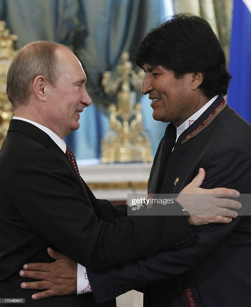 Russia's President Vladimir Putin (L) greets his Bolivian counterpart Evo Morales during a meeting at the Kremlin in Moscow, on July 2, 2013. Fugitive US intelligence leaker Edward Snowden was denied asylum by a host of countries today after applying for a safe haven in 21 nations spanning the globe in hopes of winning protection from American justice. Bolivian President Evo Morales said his country was willing to consider giving Snowden asylum. AFP PHOTO / POOL/ MAXIM SHEMETOV