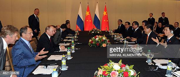 Russia's President Vladimir Putin holds talks with his China's counterpart Xi Jinping during their meeting on the sidelines of the BRICS group...