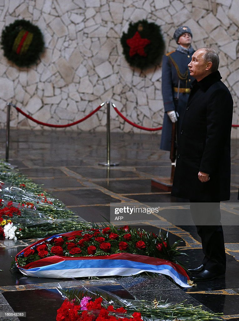 Russia's President Vladimir Putin lays a wreath at the eternal flame in the memorial on Mamayev Hill built to honour those who died in the Stalingrad Battle, in the Russian city of Volgograd, formerly Stalingrad, on February 2, 2013, during a ceremony marking the 70th anniversary of the battle. Russia marked today the 70th anniversary of a brutal battle in which the Red Army defeated Nazi forces and changed the course of World War II. AFP PHOTO / POOL/ ALEXANDER ZEMLIANICHENKO