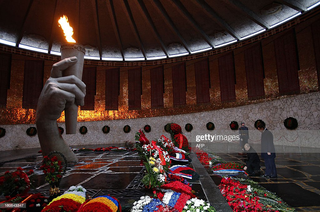 Russia's President Vladimir Putin lays a wreath at the eternal flame in the memorial on Mamayev Hill built to honour those who died in the Stalingrad Battle, in the Russian city of Volgograd, formerly Stalingrad, on February 2, 2013, during a ceremony marking the 70th anniversary of the battle. Russia marked today the 70th anniversary of a brutal battle in which the Red Army defeated Nazi forces and changed the course of World War II.