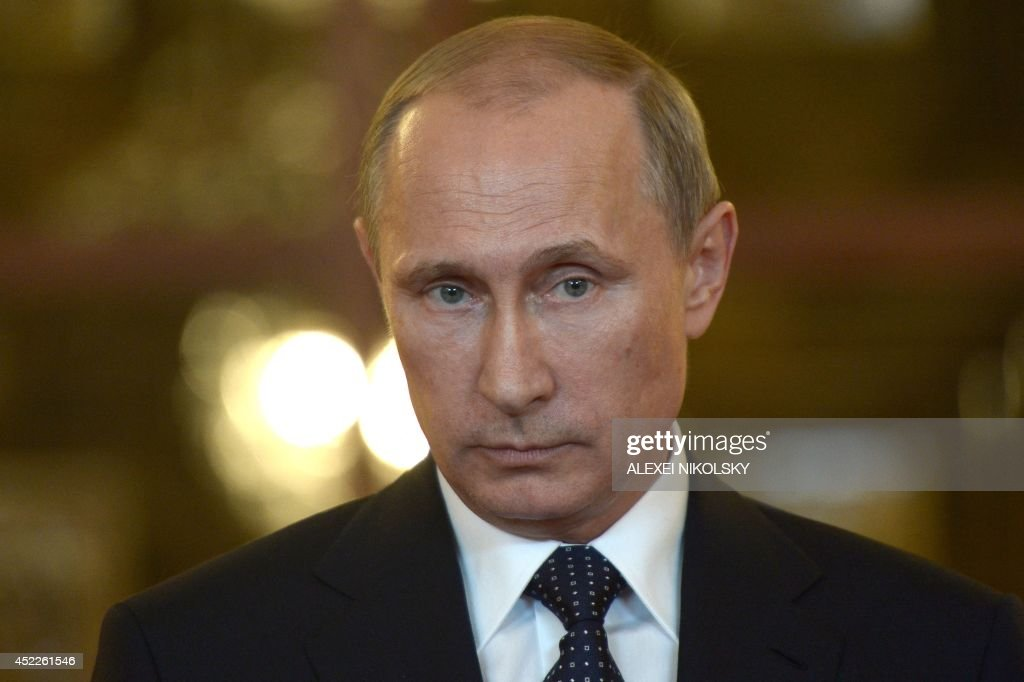 Russia's President <a gi-track='captionPersonalityLinkClicked' href=/galleries/search?phrase=Vladimir+Putin&family=editorial&specificpeople=154896 ng-click='$event.stopPropagation()'>Vladimir Putin</a> looks on while speaking with journalists in Itamaraty Palace in Brazilia, early on July 17, 2014. The United States and Europe strengthened sanctions on Moscow over Ukraine yesterday, with President Barack Obama taking his first direct swipes in the finance, military and energy sectors of the Russian economy. Putin warned the biting sanctions will boomerang and hit back at US national interests, will inflicting 'very serious damage' on an already tattered US-Russia relationship. AFP PHOTO / RIA-NOVOSTI / POOL / ALEXEI NIKOLSKY