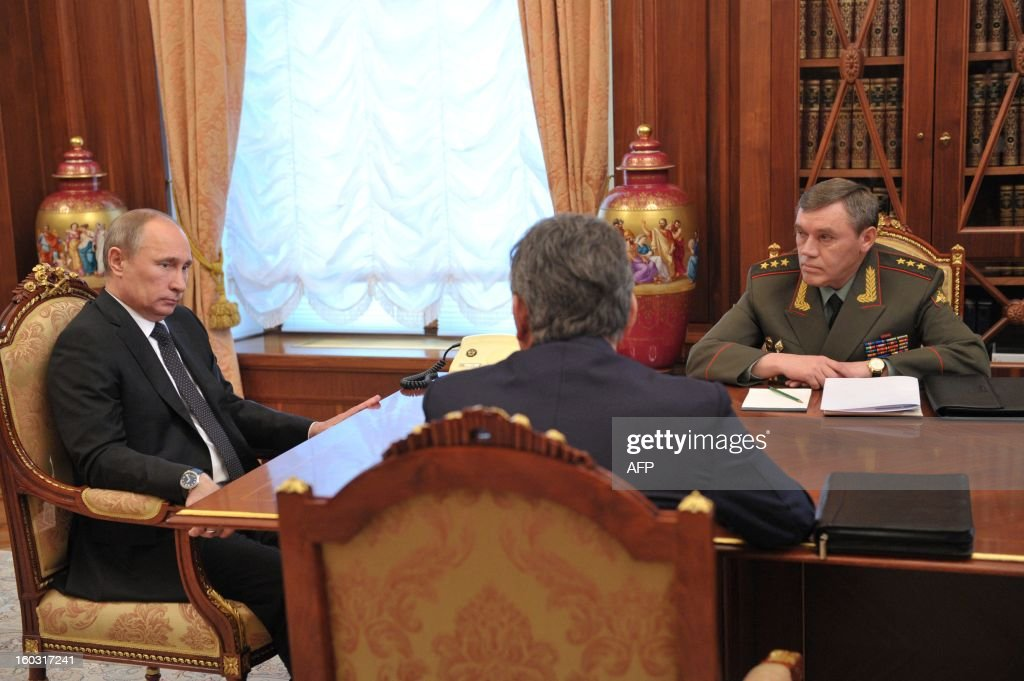 Russia's President Vladimir Putin (l) meet Defence Minister Sergei Shoigu (C) and Army chief of staff Gen. Valery Gerasimov (R) in the Kremlin in Moscow, on January 29, 2013.
