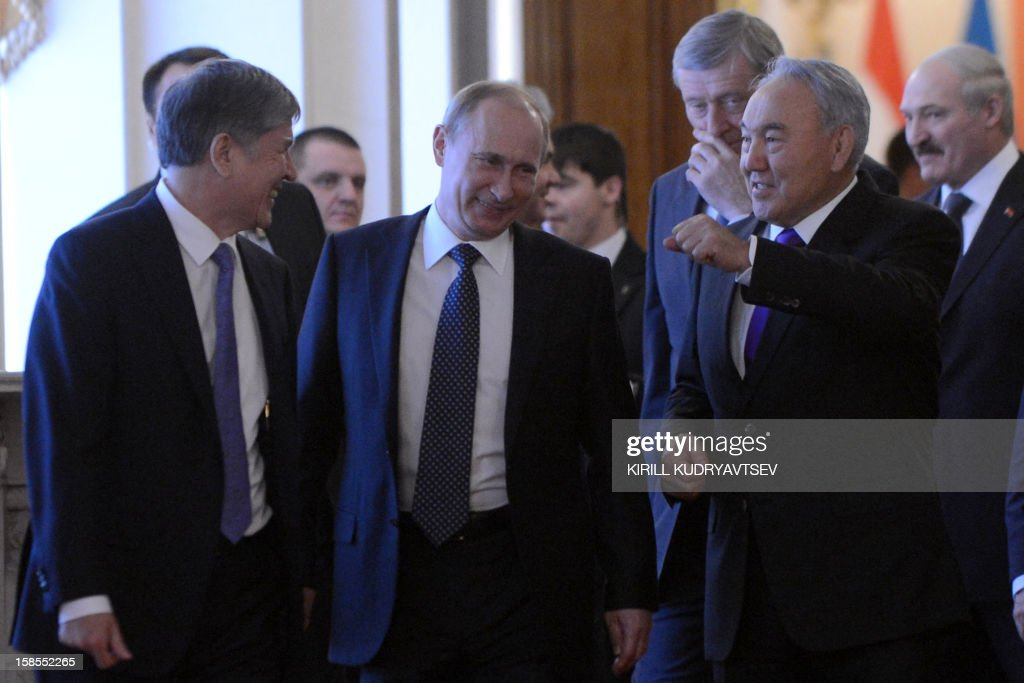 Russia's President Vladimir Putin (2nd L) meeting the leaders ex-Soviet nations in the Kremlin in Moscow, on December 19, 2012, with Belarus President Alexander Lukashenko (R), Kyrgyz President Almazbek Atambayev (L) and Kazakh President Nursultan Nazarbayev (2nd R) attending. Russia sought today to expand its sway over ex-Soviet nations as it hosted economic integration talks Washington has painted as an attempt by Moscow to 're-Sovietise' the region. AFP PHOTO / POOL / KIRILL KUDRYAVTSEV