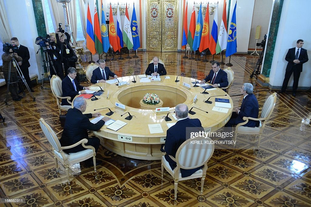 Russia's President Vladimir Putin (top C) meeting the leaders ex-Soviet nations in the Kremlin in Moscow, on December 19, 2012. Shown clockwise right from Putin are: Tajik President Emomali Rakhmon, Armenian President Serzh Sarksian, Belarus President Alexander Lukashenko, Kazakh President Nursultan Nazarbayev, Kyrgyz President Almazbek Atambayev and Collective Security Treaty Organisation (CSTO) chairman Nikolai Bordyuzha. Russia sought today to expand its sway over ex-Soviet nations as it hosted economic integration talks Washington has painted as an attempt by Moscow to 're-Sovietise' the region. AFP PHOTO / POOL / KIRILL KUDRYAVTSEV