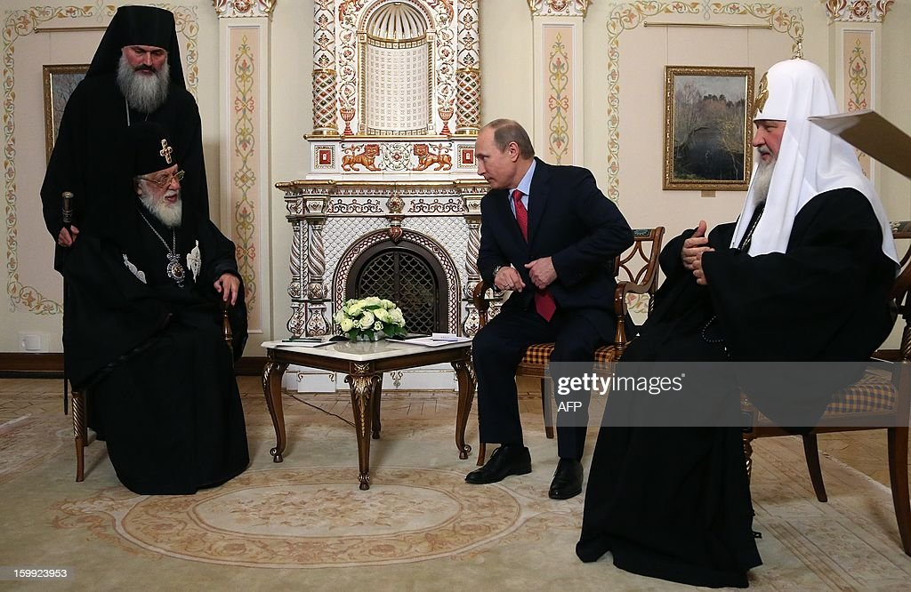 Russia's President Vladimir Putin (C) meets Catholicos Patriarch Ilia II of All Georgia (L) and Patriarch of Moscow and All Russia Kirill (R) in the Novo-Ogaryovo residence outside Moscow, on January 23, 2013.Georgia's Orthodox Church leader passed a greeting from Prime Minister Bidzina Ivanishvili to Putin as he became the most senior Tbilisi figure to visit Moscow since the two sides' brief 2008 war.