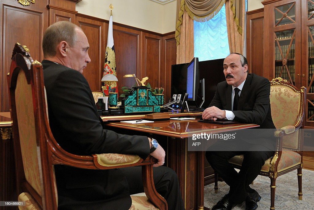Russia's President Vladimir Putin (L) meets Ramazan Abdulatipov, the new leader of Russian North Caucasus region of Dagestan, in the Kremlin in Moscow, on February 1, 2013. Putin relieved this week Dagestani leader Magomedsalam Magomedov of his post and appointed ruling party lawmaker Ramazan Abdulatipov acting head of the region on the shores of the Caspian Sea, the Kremlin said in a statement.