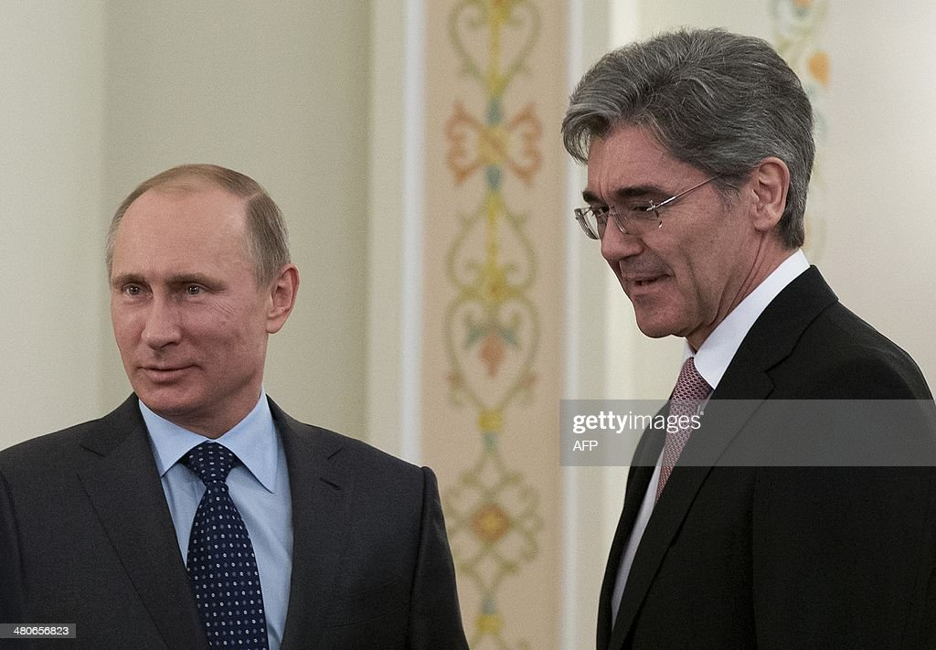 Russia's President Vladimir Putin (L) meets Siemens AG CEO, Joe Kaeser, in the Novo-Ogaryovo residence outside Moscow, on March 26, 2014.
