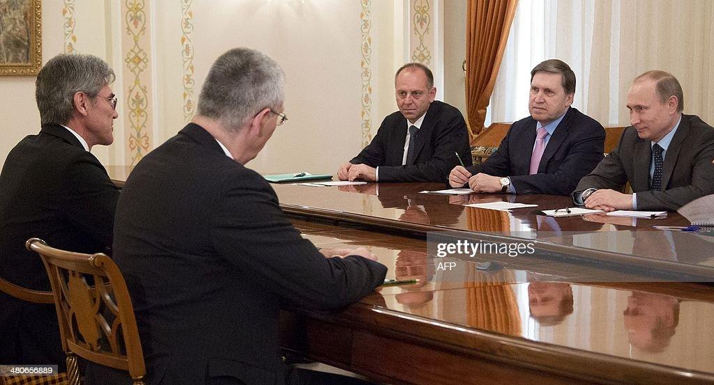 Russia's President Vladimir Putin (R) meets Siemens AG CEO, Joe Kaeser (L), in the Novo-Ogaryovo residence outside Moscow, on March 26, 2014.