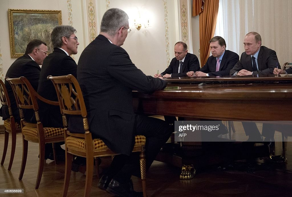 Russia's President Vladimir Putin (R) meets Siemens AG CEO, Joe Kaeser (2nd L), in the Novo-Ogaryovo residence outside Moscow, on March 26, 2014.