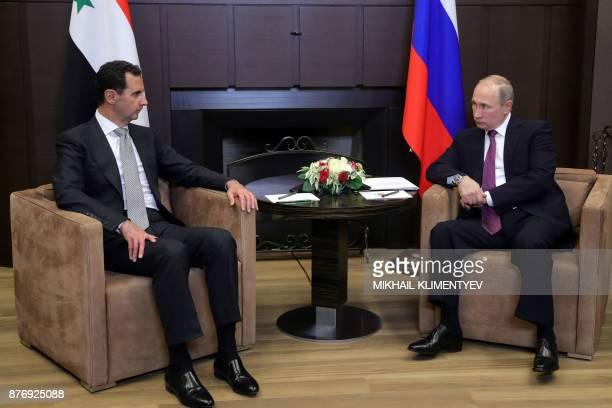 Russia's President Vladimir Putin meets with his Syrian counterpart Bashar alAssad in Sochi on November 20 2017 / AFP PHOTO / SPUTNIK / Mikhail...