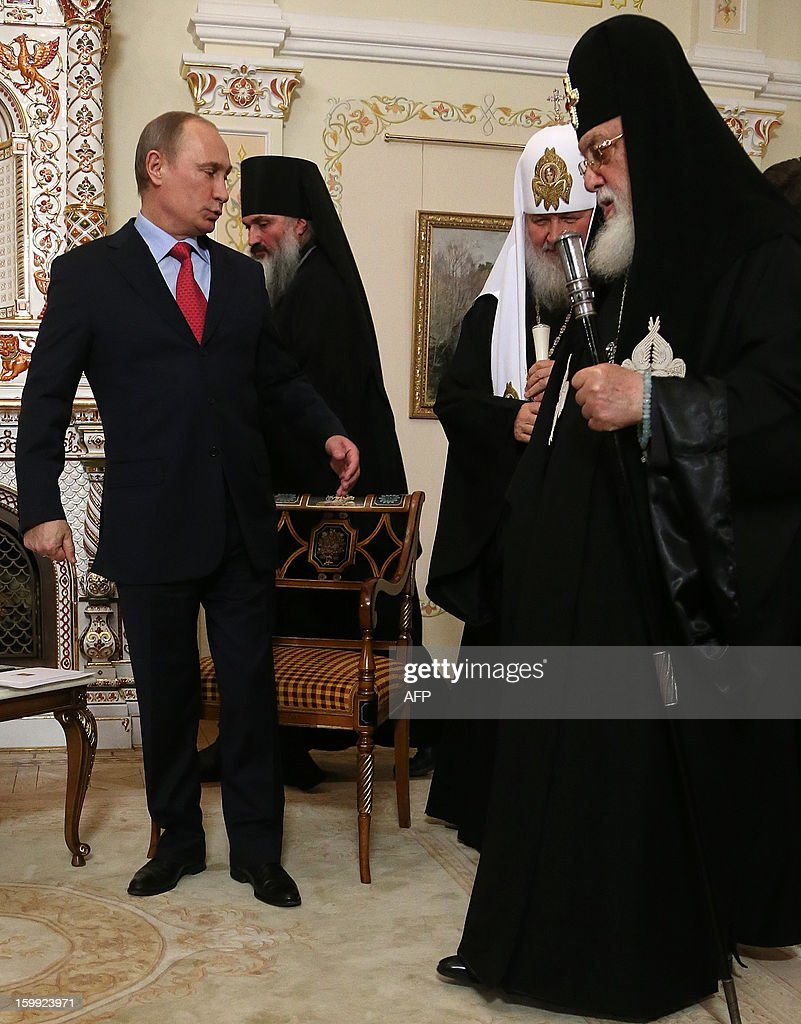 Russia's President Vladimir Putin (L), Patriarch of Moscow and All Russia Kirill (2nd R) and Catholicos Patriarch Ilia II of All Georgia (R) meet in the Novo-Ogaryovo residence outside Moscow, on January 23, 2013.Georgia's Orthodox Church leader passed a greeting from Prime Minister Bidzina Ivanishvili to Putin as he became the most senior Tbilisi figure to visit Moscow since the two sides' brief 2008 war.