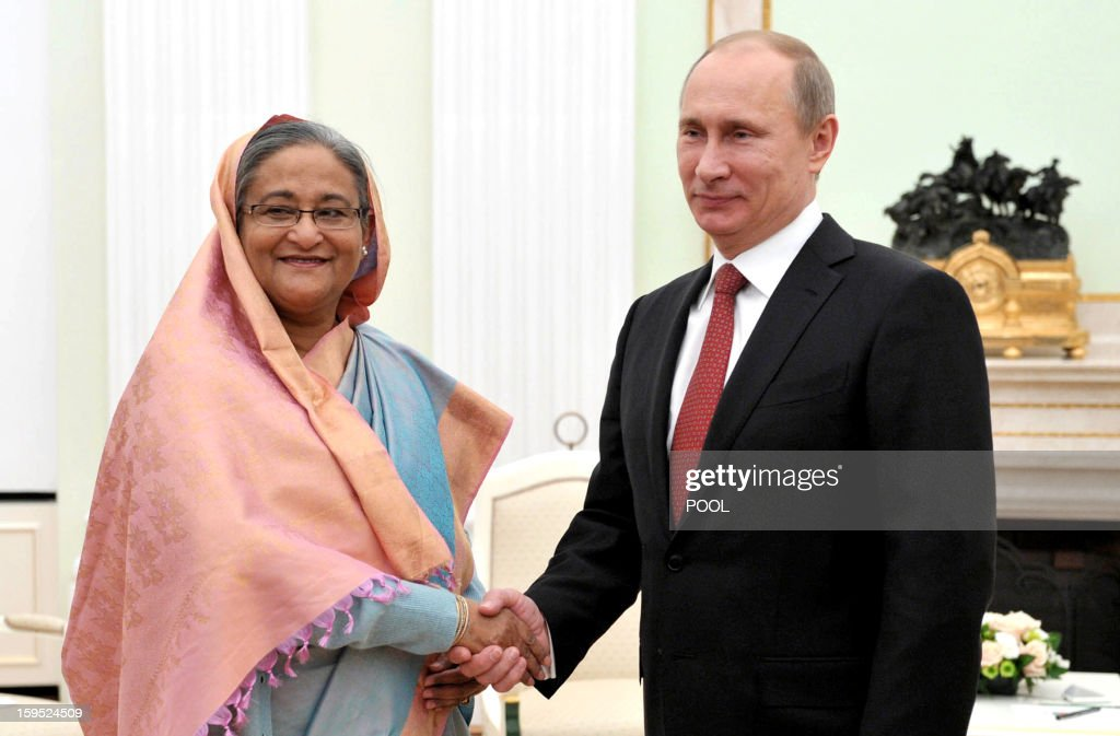 Russia's President Vladimir Putin (R) shakes hands with Bangladesh's Prime Minister Sheikh Hasina during their meeting in Moscow, on January 15, 2013. Putin met today Bangladesh's Prime Minister for talks and for the signature of the impoverished Asian nation's largest defence contract since its independence in 1971. AFP PHOTO/ RIA-NOVOSTI/ POOL/ ALEXEI NIKOLSKY