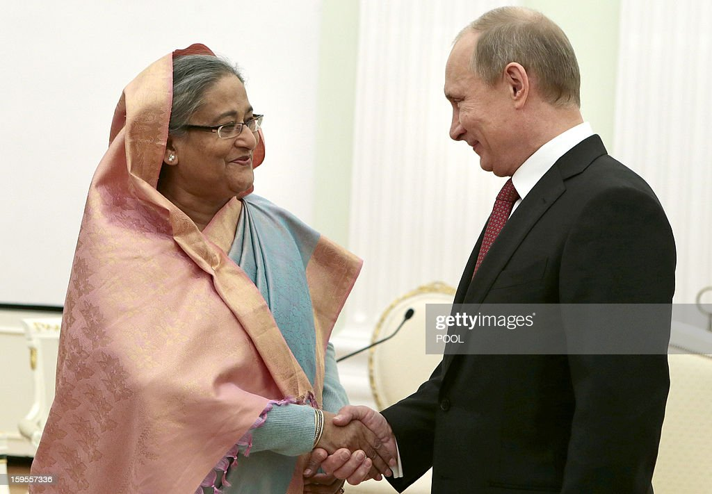 Russia's President Vladimir Putin (R) shakes hands with Bangladesh's Prime Minister Sheikh Hasina during their meeting in Moscow, on January 15, 2013. Putin met yesterday Bangladesh's Prime Minister for talks and for the signature of the impoverished Asian nation's largest defence contract since its independence in 1971.