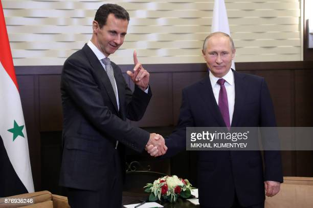 Russia's President Vladimir Putin shakes hands with his Syrian counterpart Bashar alAssad during a meeting in Sochi on November 20 2017 Russian...