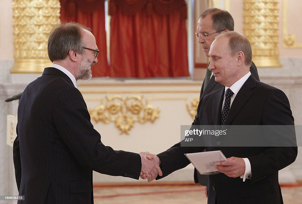 Russia's President Vladimir Putin (R) shakes hands with newly-appointed Dutch ambassador Ronald van Dartel during a ceremony to hand over the diplomatic credentials at the Kremlin in Moscow, on October 23, 2013. The year 2013 was officially supposed to be one of cultural exchange to highlight the friendship between Russia and the Netherlands whose friendship dates back to the 1697 Peter the Great's visit. But lately, the relations between Russia and the Netherlands have deteriorated over last month Moscow's arrest of the 30-member crew of a Dutch-flagged Greenpeace ship, the brief detention of a Russian diplomat in the Netherlands, the assault on a senior Dutch diplomat in his Moscow apartment and the Russian embassy flat break-in at The Hague.