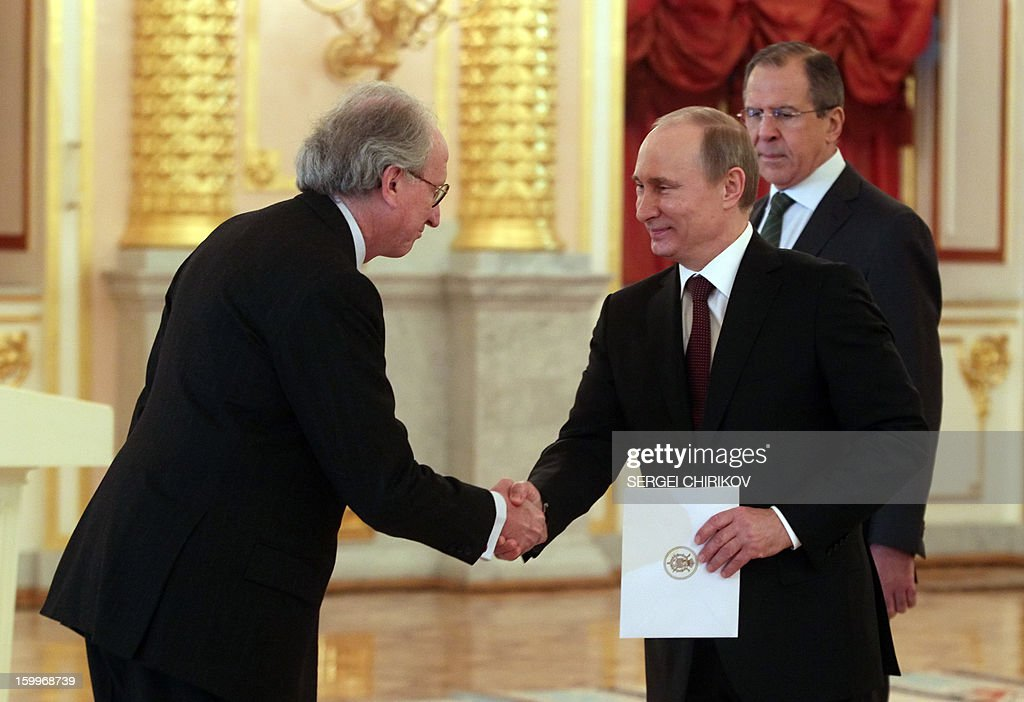 Russia's President Vladimir Putin (2nd L) shakes hands with the Spain's ambassador Jose Ignacio Carbajal Garate (L) during a ceremony of receiving ambassadors' credentials in the Grand Kremlin palace in Moscow, on January 24, 2013, with Russian Foreign Minister Sergei Lavrov (R) attending. AFP PHOTO/ POOL/ SERGEI CHIRIKOV