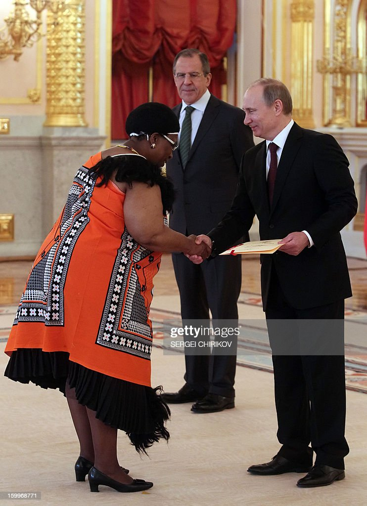 Russia's President Vladimir Putin (R) shakes hands with the Swaziland's new ambassador Tembayena Annastasia Dlamini (L) during a ceremony of receiving ambassadors' credentials in the Grand Kremlin palace in Moscow, on January 24, 2013, with Russian Foreign Minister Sergei Lavrov (C) attending.