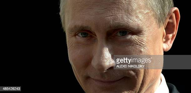Russia's President Vladimir Putin smiles as he speaks with journalists after his annual televised questionandanswer session with the nation at...