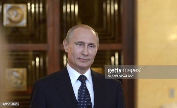 Russia's President Vladimir Putin smiles while speaking with journalists in Itamaraty Palace in Brazilia early on July 17 2014 The United States and...
