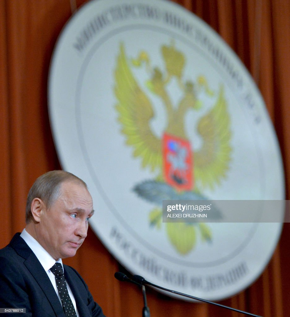 Russia's President Vladimir Putin speaks at a meeting of Russian ambassadors and permanent representatives in foreign countries held at the Foreign Ministry in Moscow on June 30, 2016. Russian President Vladimir Putin on June warned that the fallout from Britain's vote to leave the European Union would last a long time. 'Brexit -- that is the choice of the subjects of Great Britain and we have not in any way interfered in this and are not interfering,' Putin told Russian diplomats in Moscow. / AFP / Sputnik / Alexei Druzhinin