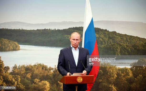 Russia's President Vladimir Putin speaks during a media conference at the conclusion of the G8 summit at the Lough Erne resort near Enniskillen in...