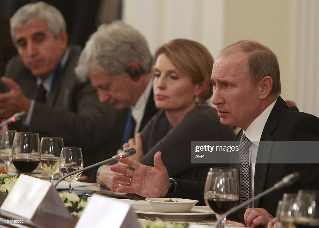 Russia's President Vladimir Putin (R) speaks during a meeting of the Valdai international discussion group of experts at the Novo-Ogaryovo residence outside Moscow on October 25, 2012.
