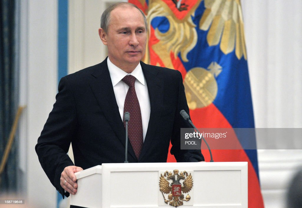 Russia's President Vladimir Putin speaks during an awarding ceremony at the Kremlinin the Kremlin in Moscow, on December 26, 2012. Russia's upper house of parliament unanimously backed today a bill barring Americans from adopting Russian children, leaving the controversial measure in the hands of Putin.