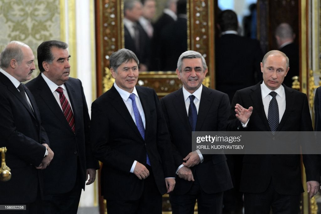 Russia's President Vladimir Putin (R) speaks while meeting the leaders ex-Soviet nations in the Kremlin in Moscow, on December 19, 2012, with Belarus President Alexander Lukashenko (L), Tajik President Emomali Rakhmon (2nd L), Kyrgyz President Almazbek Atambayev (C) and Armenian President Serzh Sarksian (2nd R) attending. Russia sought today to expand its sway over ex-Soviet nations as it hosted economic integration talks Washington has painted as an attempt by Moscow to 're-Sovietise' the region.