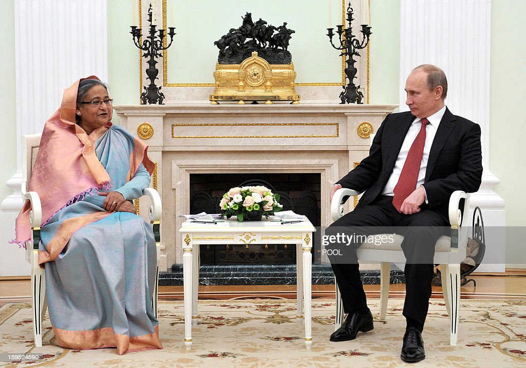 Russia's President Vladimir Putin (R) speaks with Bangladesh's Prime Minister Sheikh Hasina during their meeting in Moscow, on January 15, 2013. Putin met today Bangladesh's Prime Minister for talks and for the signature of the impoverished Asian nation's largest defence contract since its independence in 1971.