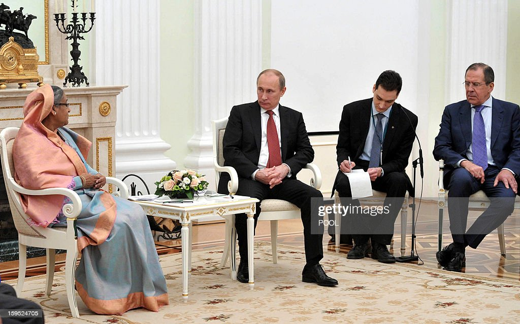 Russia's President Vladimir Putin (2nd L) speaks with Bangladesh's Prime Minister Sheikh Hasina (L) during their meeting in Moscow, on January 15, 2013, with Russian Foreign Minister Sergei Lavrov (R) attending. Putin met today Bangladesh's Prime Minister for talks and for the signature of the impoverished Asian nation's largest defence contract since its independence in 1971. AFP PHOTO/ RIA-NOVOSTI/ POOL/ ALEXEI NIKOLSKY