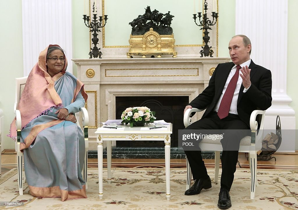 Russia's President Vladimir Putin (R) speaks with Bangladesh's Prime Minister Sheikh Hasina during their meeting in Moscow, on January 15, 2013. Putin met today Bangladesh's Prime Minister for talks and for the signature of the impoverished Asian nation's largest defence contract since its independence in 1971. AFP PHOTO/ POOL/ MIKHAIL METZEL