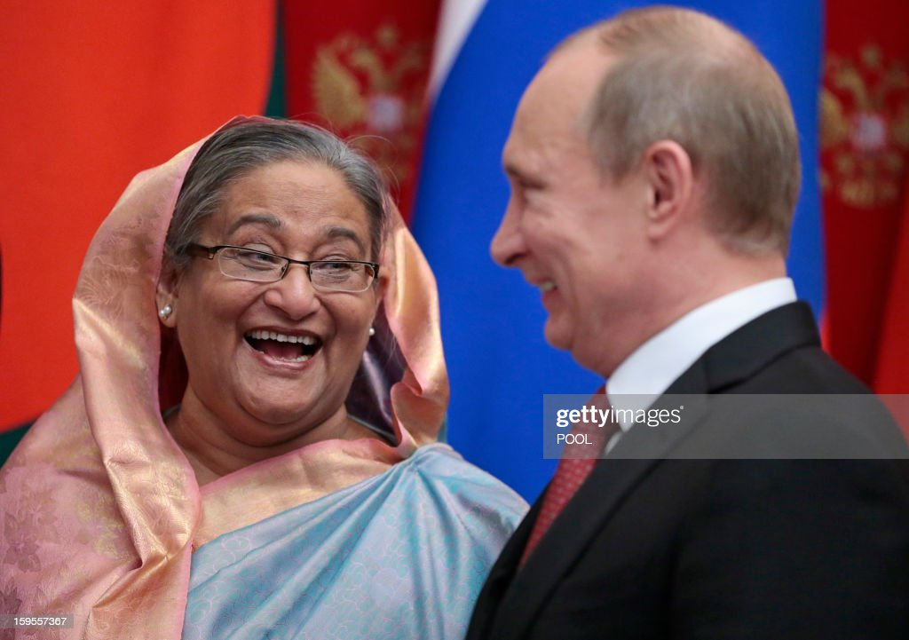 Russia's President Vladimir Putin (R) speaks with Bangladesh's Prime Minister Sheikh Hasina during their meeting in Moscow, on January 15, 2013. Putin met yesterday Bangladesh's Prime Minister for talks and for the signature of the impoverished Asian nation's largest defence contract since its independence in 1971.