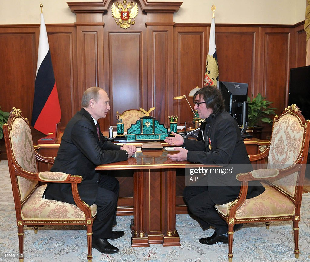 Russia's President Vladimir Putin (L) speaks with conductor Yuri Bashmet during their meeting in the Kremlin in Moscow, on January 24, 2013, to mark Bashmet's birthday. The renown conductor turned 60 today.