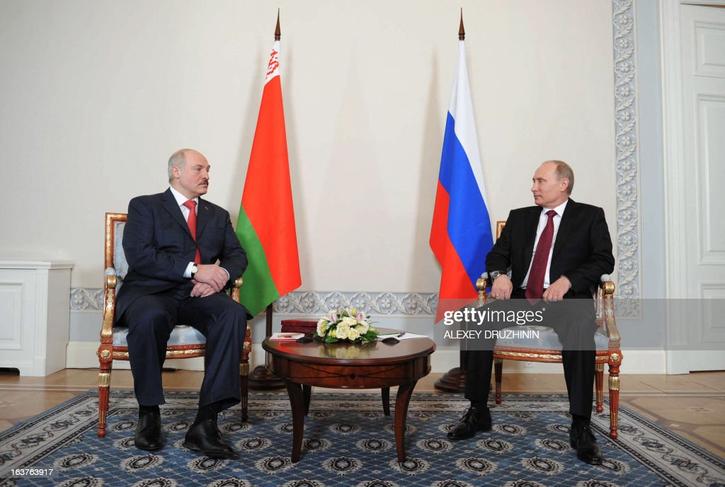 Russia's President Vladimir Putin (R) speaks with his Belarus counterpart Alexander Lukashenko during their meeting at the Konstantinovsky palace in Strelna just outside St.Petersburg, on March 15, 2013.