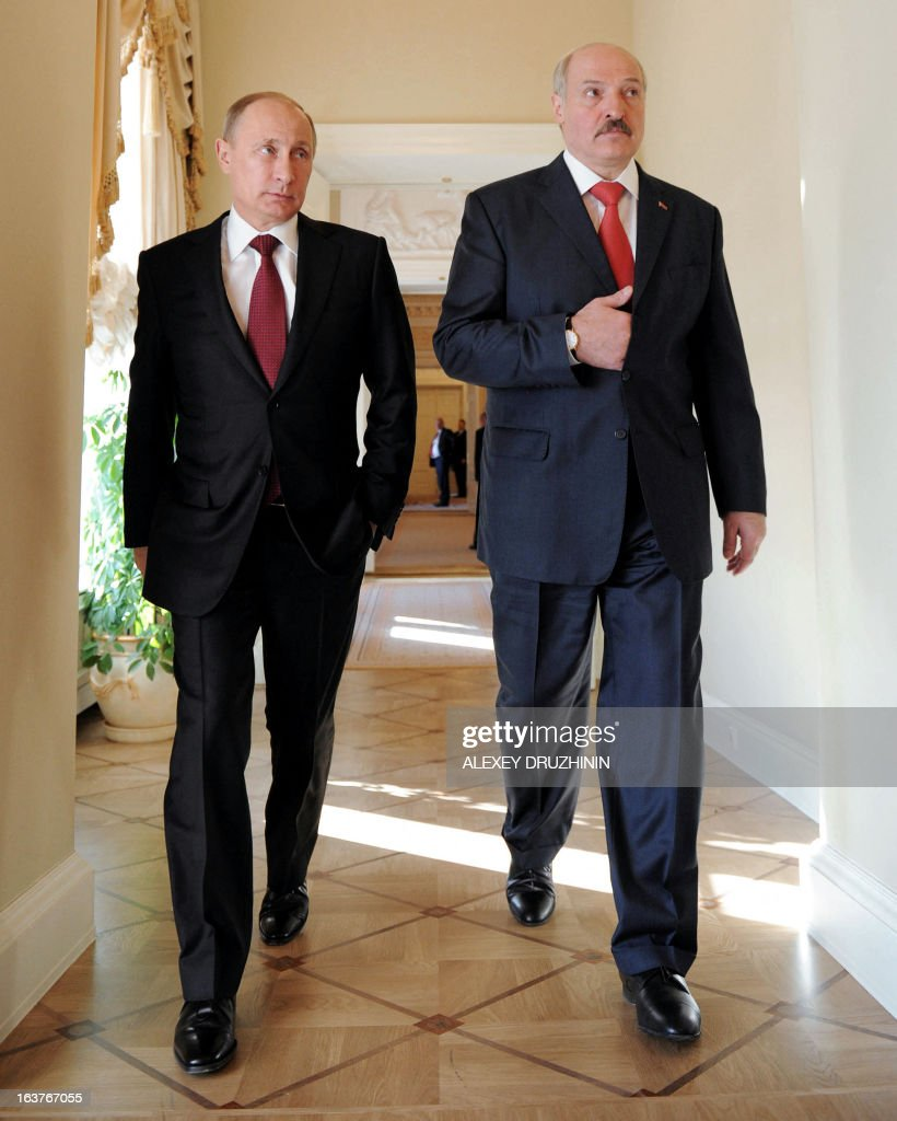 Russia's President Vladimir Putin (L) speaks with his Belarus counterpart Alexander Lukashenko as they walk during their meeting at the Konstantinovsky palace in Strelna just outside St.Petersburg, on March 15, 2013.