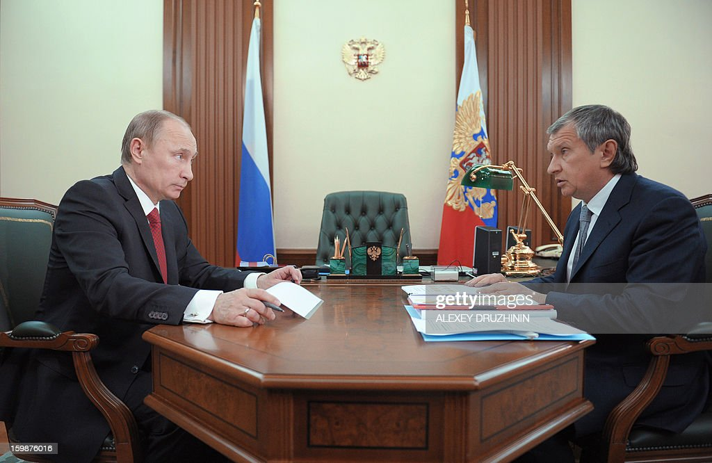 Russia's President Vladimir Putin (L) speaks with Igor Sechin, the CEO of state-controlled Russian oil giant Rosneft, during their meeting in Putin's Novo-Ogaryovo residence outside Moscow, on January 22, 2013.